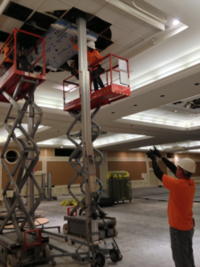 Workers install electrical equipment